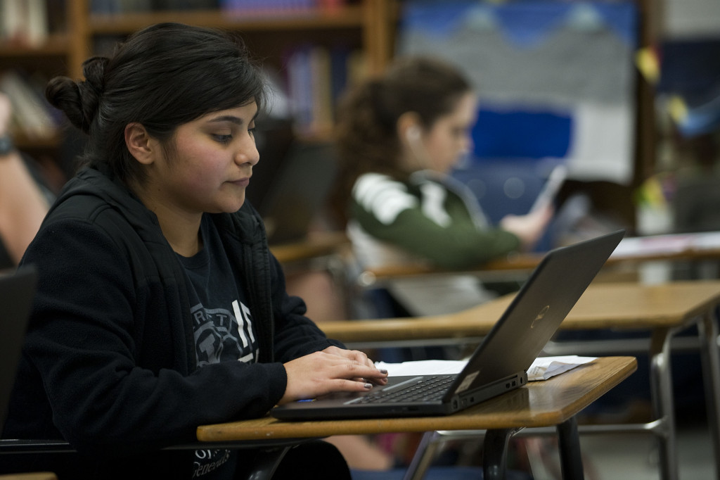 Nayeli Juarez, 18, of Mount Jackson, works on an English paper on a  laptop recently at Stonewall Jackson High School. Juarez will attend James Madison University on a full scholarship this fall.  Rich Cooley/Daily
