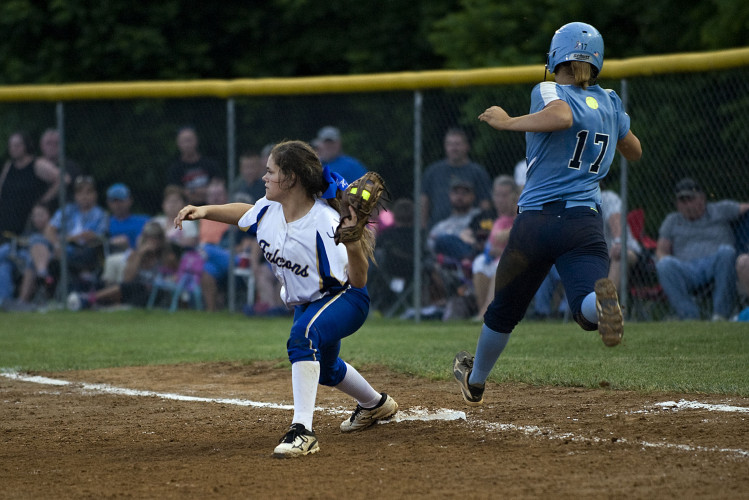 Central first baseman Kristina Stead beats Page County's Kate Gordon  to the bag during last Friday's game in Woodstock. Rich Cooley/Daily