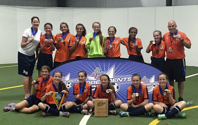 The Winchester United U-12 soccer team poses for a picture after winning the USYSA Region I President's Cup in Reisterstown, Maryland recently.  Front Row:  Mikayla Balio, Olivia Walker, Riley Donelan, Sidney Rathel, Shayla Fitzsimmons-Call, and Adyson Gloyd.  Back Row:  Coach Elizabeth Pike, Caron Foltz, Julia Nerangis, Kendall Lincoln, Sadie Kerns, Hannah Fletcher, Jessica Alamo, Peyton Duvall, and Coach Cosmo Balio. Courtesy photo/Cosmo Balio