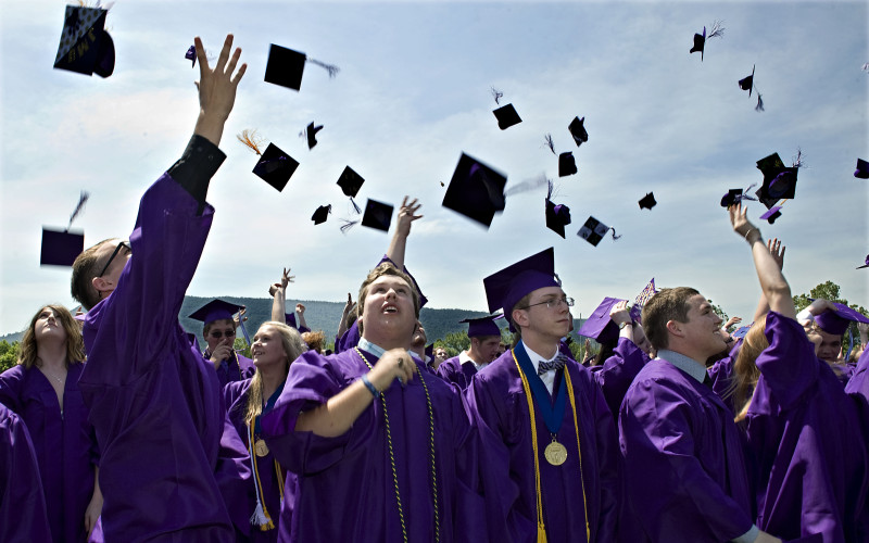 Strasburg High School graduates toss their caps at the end of graduation ceremonies Saturday morning at the school. There were 151 seniors receiving diplomas. Rich Cooley/Daily