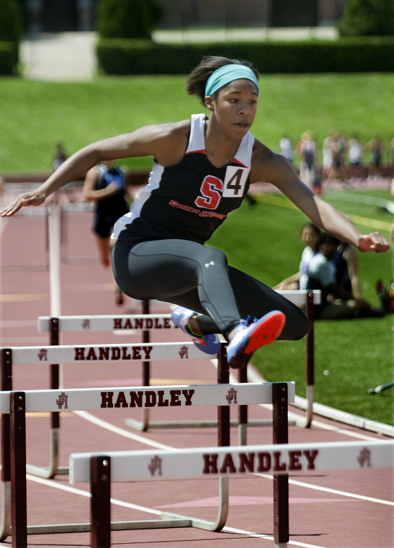 Sherando's Davina Lane leaves the competition behind in the 300-meter hurdles earlier this season. Lane won the Group 4A state title in both the 100-meter hurdles and the 300-meter hurdles. Rich Cooley/Daily file