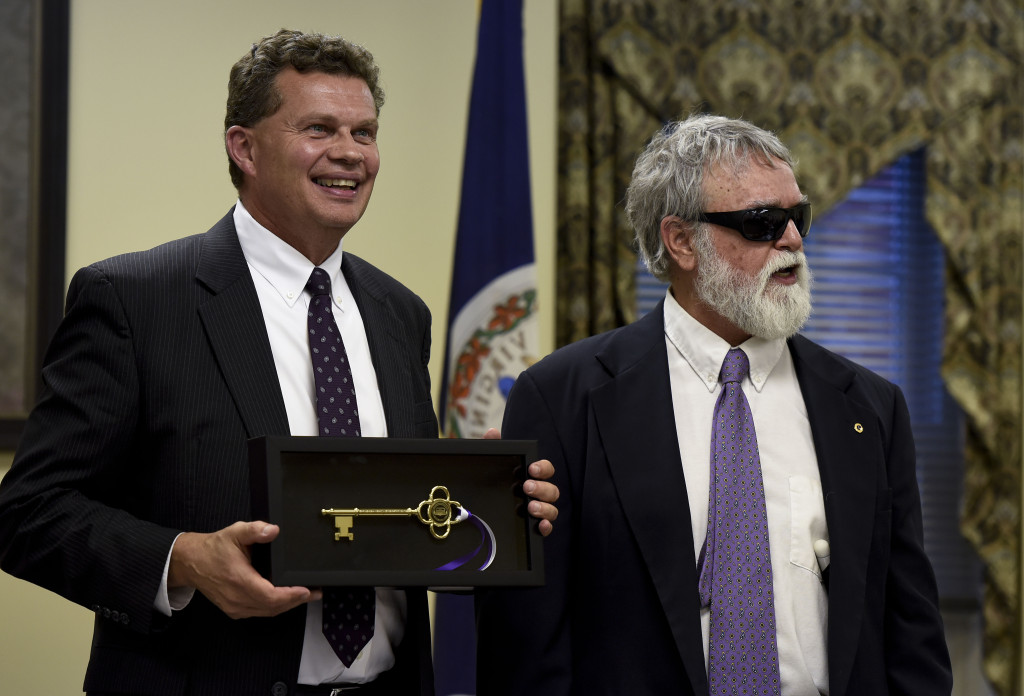 Strasburg Mayor Tim Taylor, left,  holds a key to the town that was presented to him Tuesday night during his last council meeting. Tuesday also marked the last meetings of Councilmen Richard Redmon, right,  and Bob Baker.  Rich Cooley/Daily