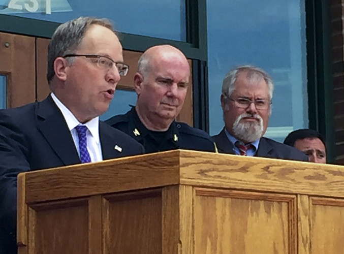 U.S. Attorney John P. Fishwick Jr., left, praises area efforts to stop heroin trafficking at a news conference in front of the Winchester Police Department on Wednesday afternoon. Other area officials at the conference included, second from left:  Winchester Police Chief Kevin Sanzenbacher, Drug Enforcement Agency  Agent Stanley Kennedy, and Virginia State Police Special Agent Jay Perry. Rachel Mahoney/Daily