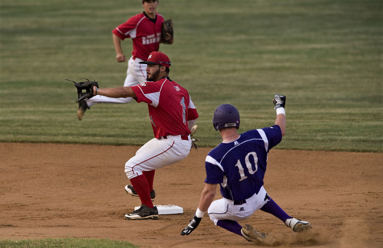 Front Royal Cardinal's second baseman Michael Centeno waits on a throw as Strasburg's Jeffrey Scott steals second base during second inning action Wednesday night at Bing Crosby Stadium in Front Royal. Rich Cooley/Daily