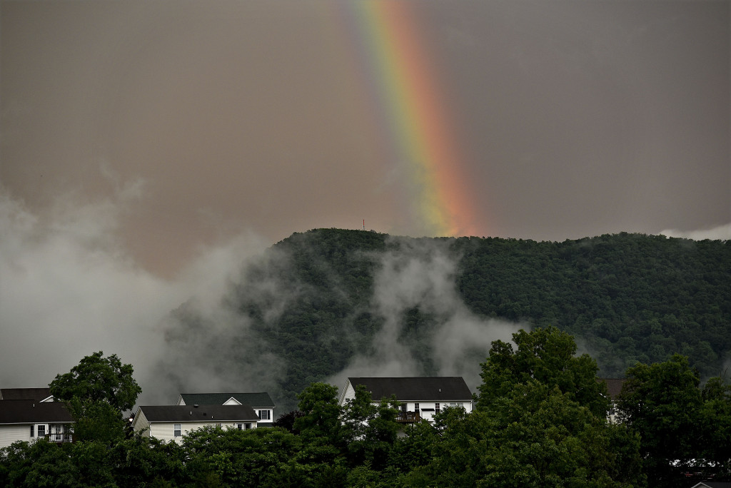 A rainbow appears over Massanutten Mountain near Signal Knob in Strasburg after Thursday evening's storm. Rich Cooley/Daily