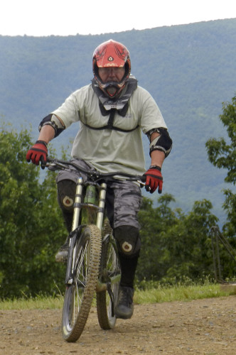 Stan Duda, of Reston, starts down the mountain on one of Bryce Resort's mountain biking trails.  Nathan Budryk/Daily
