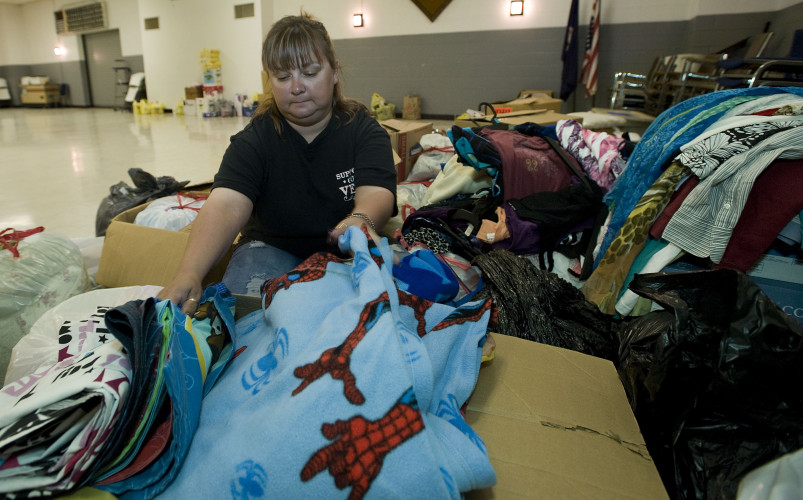 Penny Shipe, secretary of Toms Brook Volunteer Fire Department, inventories a box of blankets that were donated for West Virginia flood victims inside the department's social hall Monday morning. The fire department is a drop area were donated non-perishable supplies. Items may be dropped off between 9 a.m. and 9 p.m. until the first trailer is full. Rich Cooley/Daily