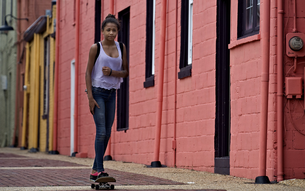 Cherokee Myers, 13, of Front Royal, skateboards along an alleyway off Main Street in Front Royal on a recent summer afternoon.  Rich Cooley/Daily