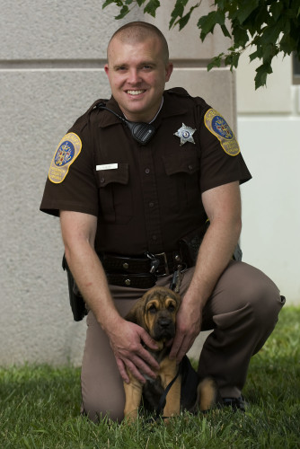 Frederick County Sheriff's Office deputy A. Jeter is the K-9 handler for the department's new  bloodhound puppy.  Rich Cooley/Daily