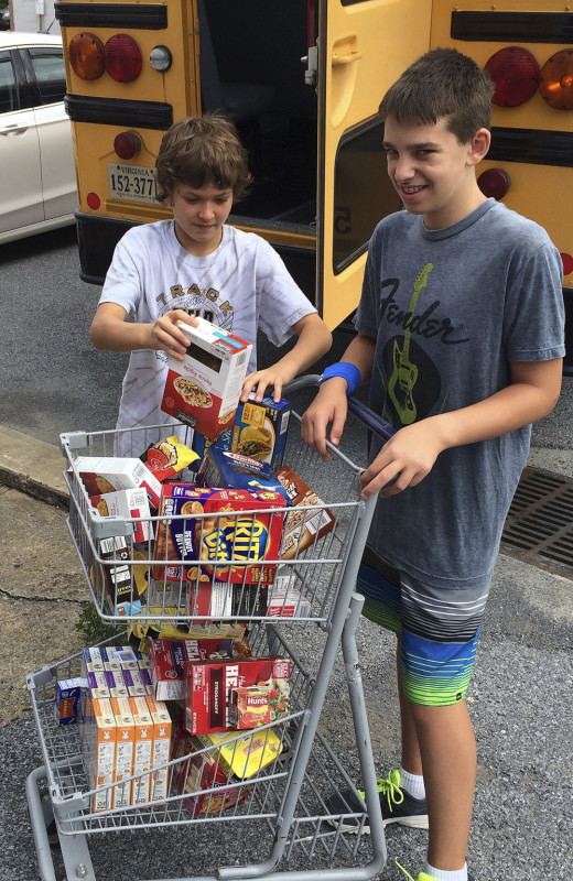 Patrick Truetlien and Jack Shultzaberger, both of Warren County and members of the Blue Ridge Environmental Governor's School, collected food and hygiene goods for the Restore Hope House food pantry in Strasburg. In four days, the school, which is based at Signal Knob Middle School for two weeks this summer,  collected 870 pounds of food and other goods to donate.  Courtesy photo
