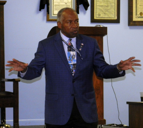 Retired Air Force Col. Norman McDaniel addresses those assembled at Front Royal's Unity Masonic Lodge on Wednesday. McDaniel was captured by the North Vietnamese during the Vietnam War and held for more than six years.  Nathan Budryk/Daily