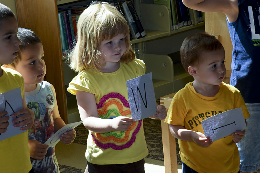 Josh Pastalove, left, Gideon Steiner, Claire Wampler and Levi Alley spell out words at the start of the summer reading program in June at the New Market Area Library. Programs are held at 10 a.m. each Thursday through Aug. 11. Courtesy photo