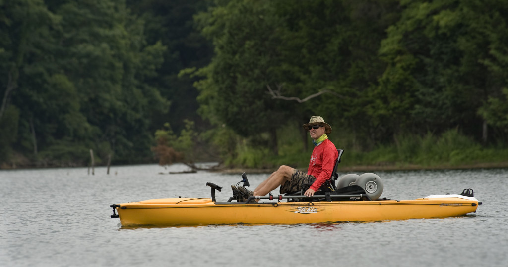 Joe Cox, of Stephens City, pedals his kayak while fishing along Lake Frederick on a recent summer morning.   Rich Cooley/Daily