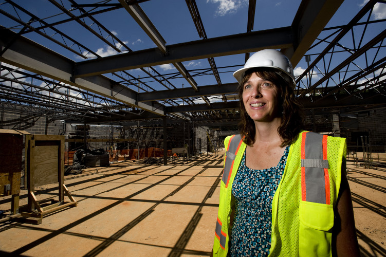 Amy Gubler, principal for the new Warren County Middle School, stands inside the library during a tour this week. The school is expected to be finished July 2017. Rich Cooley/Daily