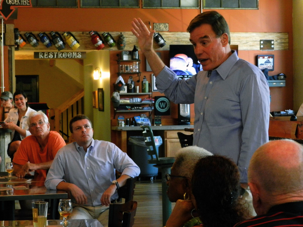 Sen. Mark Warner answers questions from the crowd during his visit to the  Woodstock Brewhouse on Sunday afternoon. Rachel Mahoney/Daily