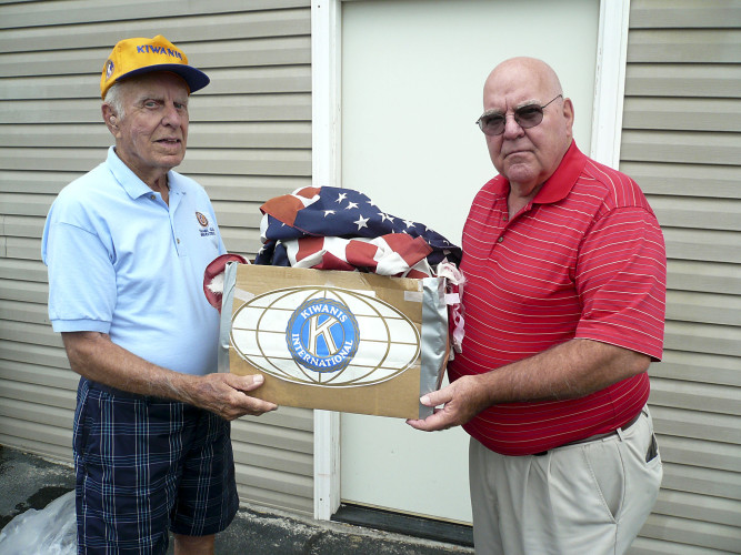 Doug Butler, left, of the Kiwanis Club of Winchester, and Conrad-Hoover of the American Legion Post 21 delivered the Kiwanis Club's 100th worn, torn American flag to Bruce Saville for proper disposal. The Kiwanis Club provides replacement flags at no cost. Information: 540-667-0356. Courtesy photo
