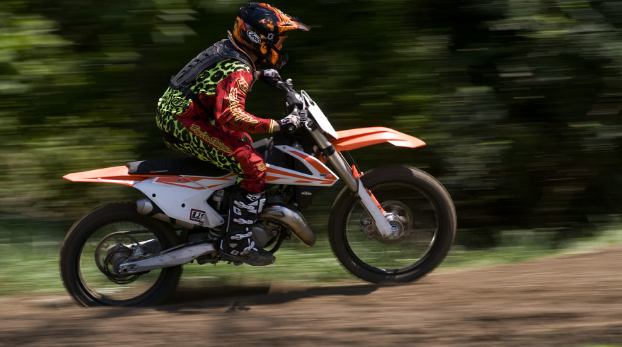 Orion Gregory, 13, races his motocross dirt bike on a course his family built near their Stephens City home. Orion will be competing in the Amateur National Motocross Championship on Aug. 1 in Tennessee.   Rich Cooley/Daily