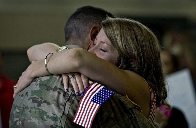 Sgt. Ryan Croft, a member of the Virginia National Guard 3rd Battalion, 116th Infantry Regiment based in Woodstock, hugs his wife, Christine in July after they were reunited following his deployment in Qatar.  Rich Cooley/Daily