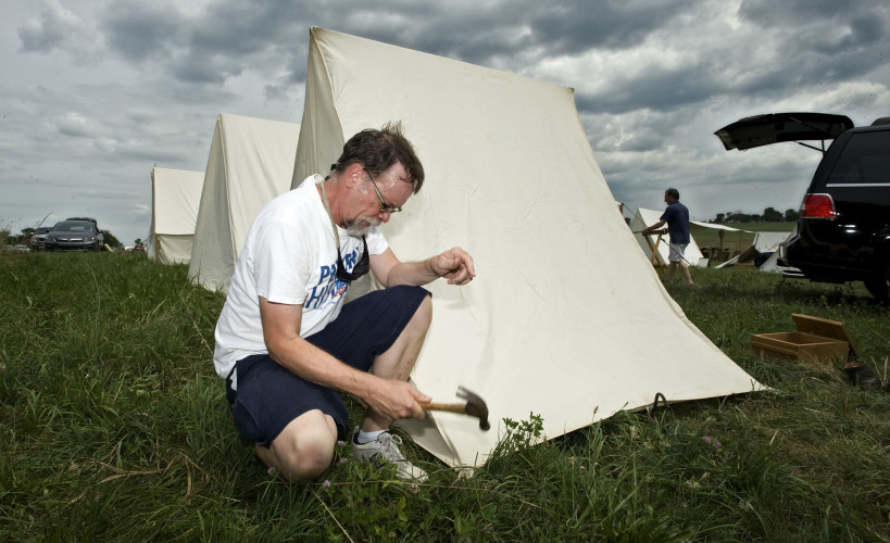 Chuck Critchfield, of Clarksburg, West Virginia, pitches his tent at the federalist camp at the Cedar Creek Battlefield   on Friday afternoon. There will be re-enactments of battles of the First Bull Run - Manassas this weekend at the Middletown battlefield.   Rich Cooley/Daily