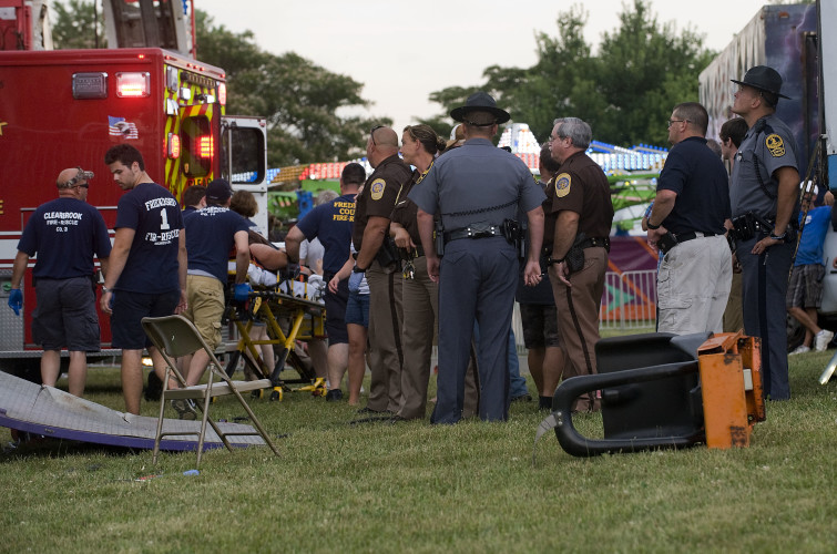 Fire and Rescue personnel prepare to transport a person who was injured after a malfunction of the Super Shot ride at the Frederick County Fairgrounds on Monday evening. According to Frederick County Deputy Chief/Fire Marshal Jay Bauserman, a person was injured following a 7:15 p.m. accident involving the ride. Bauserman said Monday evening he couldn't give further details.   Rich Cooley/Daily