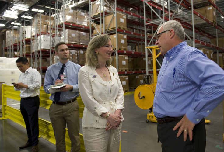 Rep. Barbara Comstock, left, speaks with Paul Vitagliano, right, vice president and general manager of Thermo Fisher Scientific in Middletown, during a tour on Tuesday.  Rich Cooley/Daily