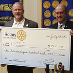 Jim Eastham, past president of the Rotary Club of Front Royal, presents a check for $1,500 to Doug Stanley, president of the Warren County Educational Endowment.  Courtesy photo