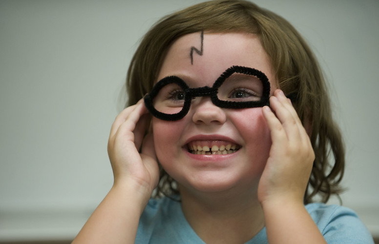 Ayla Strauss, 5, of Edinburg, models her Harry Potter glasses made from pipe cleaners during Shenandoah County Library's Harry Potter Party, held Friday evening. Rich Cooley/Daily