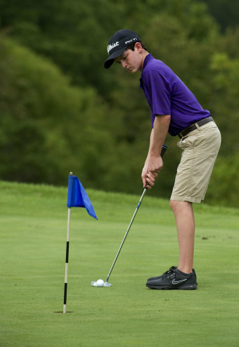 Austin Stickles, 15, of Strasburg putts outside Blue Ridge Shadows Golf Club during a recent practice session.  Rich Cooley/Daily
