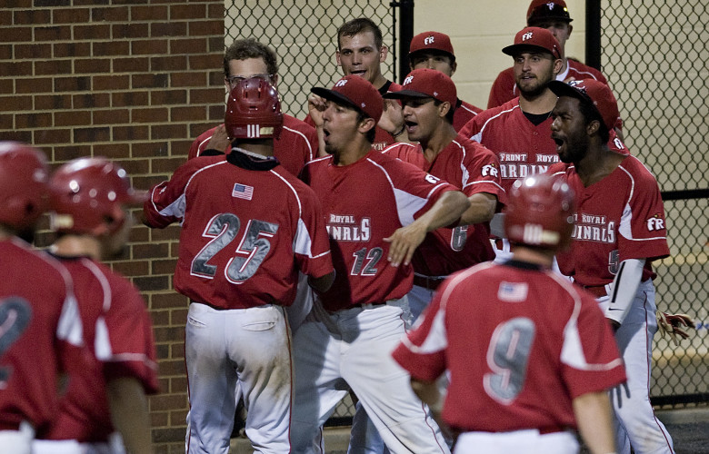 The Front Royal Cardinals' dugout clears after scoring three runs off a double by Martin Napleton against Strasburg on Tuesday night at Bing Crosby Park.  Rich Cooley/Daily