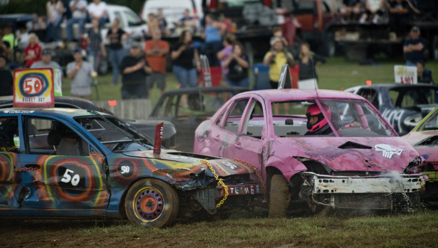 Melissa Merchant, right, takes a hit during the demolition derby Thursday night at the Warren County Fair. Rich Cooley/Daily