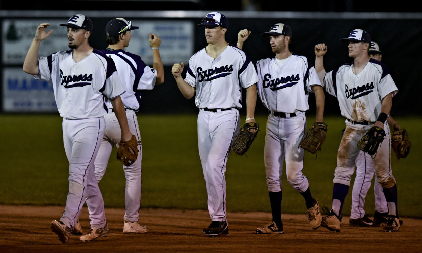 Strasburg Express' Brandon Quaranta leads the team's procession off the field after beating the Front Royal Cardinals Wednesday night 12-4 during the Valley League baseball semifinals. The Express will now face the Waynesboro Generals in the finals. Rich Cooley/Daily