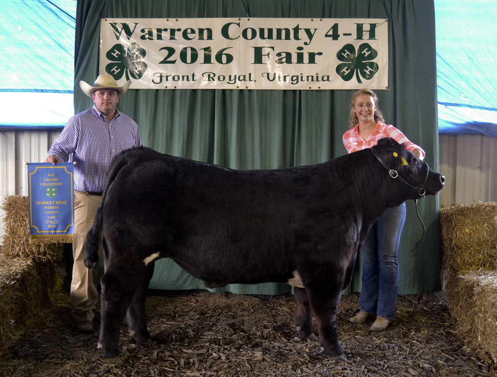 Katelynn Barron won Grand Champion Market Steer at the Warren County Fair this week. Also pictured is judge Alan Heishman.  Photo courtesy of Stacy Swain