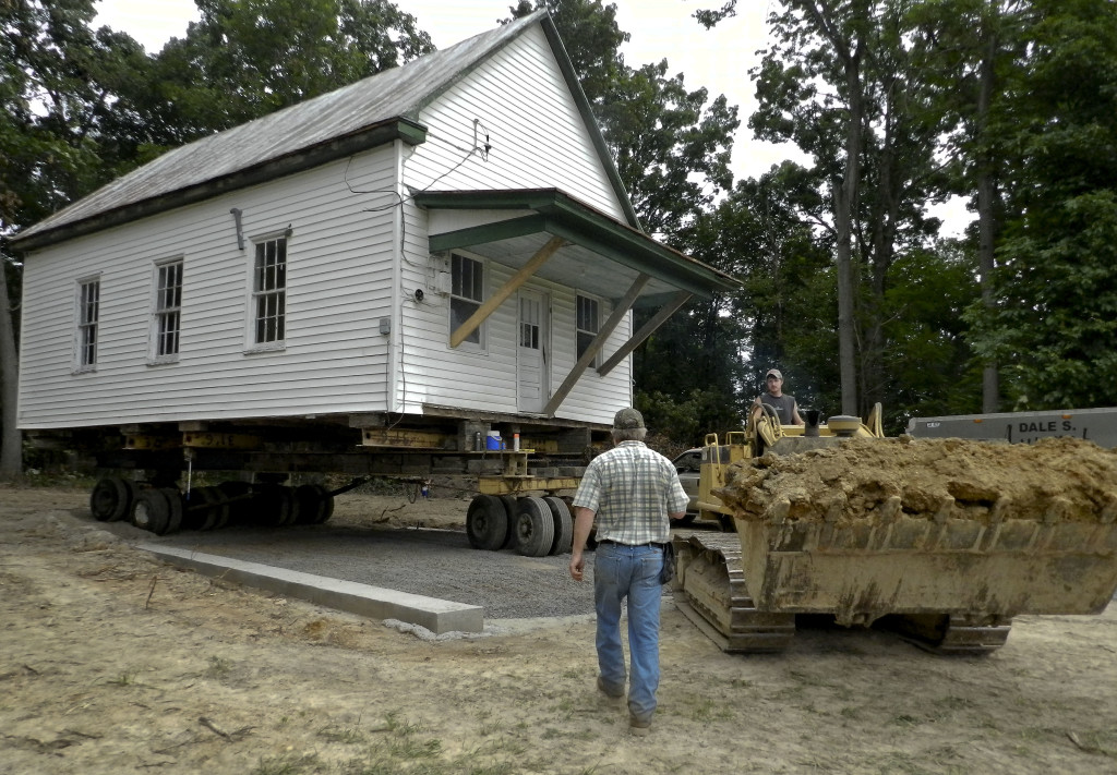 Dale S. Aungst House Movers maneuver the former Pine Grove schoolhouse into place at a new spot across the street from where it has stood in Clary for more than 100 years. Rachel Mahoney/Daily