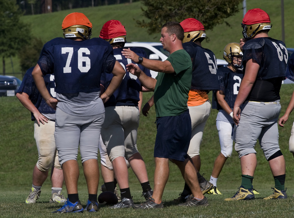 Skyline coach Heath Gilbert works with his team during a recent practice. The Hawks will have a young and inexperienced team this season. Rich Cooley/Daily