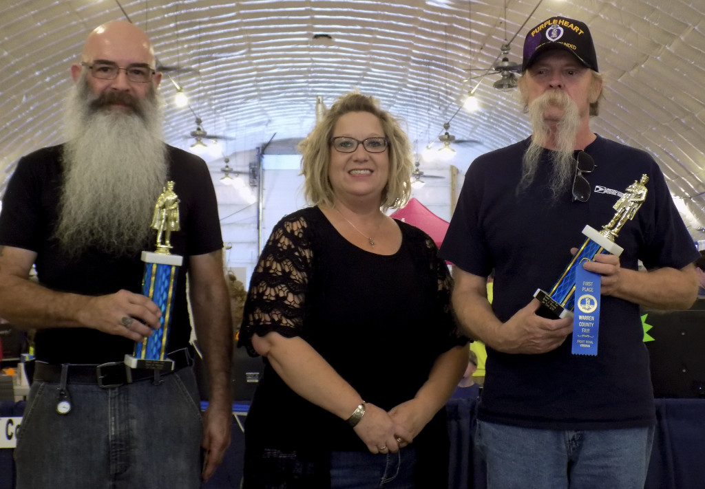 Winners of the Warren County Fair Beard and Mustache Contest at last week's fair were Dubby White, left, best in Show winner, and Larry Webb, first runner up.  The judge was Amy Rector, center, a hairdresser from Hair's the Place in Middletown.  Courtesy photo