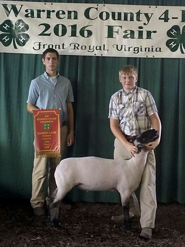 Caleb Barron, right, won the Reserve Grand Champion market lamb contest at the Warren County Fair last week. At left is Cody Boden, contest judge.   Courtesy photo