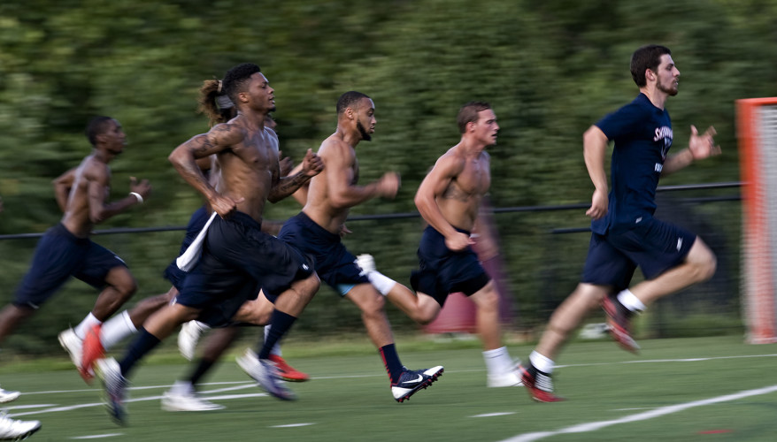 Shenandoah University's football team started held its first official day of practice Thursday. Here, players run sprints the length of the football field.   Rich Cooley//Daily