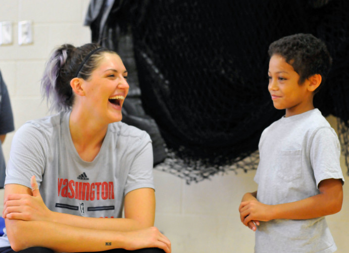 Washington Mystics center Stefanie Dolson shares a laugh with Ethan Tran, 8.  Dolson visited Sherando High School on Saturday with her team to practice in front of local youth basketball players before leading them in a skills clinic. Jake Zuckerman/Daily