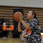 Clinic participant Camille Zinaich prepares to shoot for the basket. Jake Zimmerman/Daily