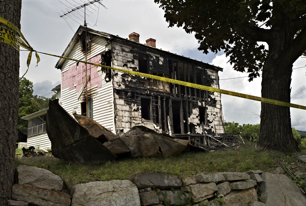 Fire heavily damaged a home at 870 Burke Hill Road near Maurertown on Friday. The house was not inhabited.   Rich Cooley//Daily