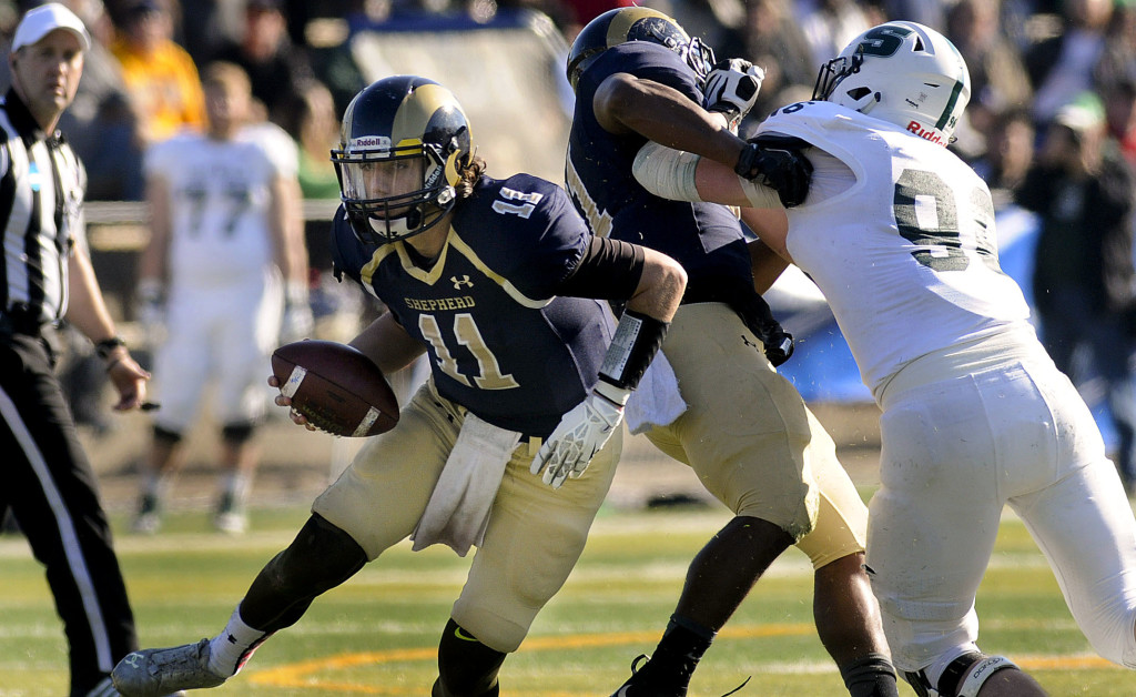 Shepherd quarterback  Jeff Ziemba (11) scrambles for yardage against Slippery Rock during third-quarter action last season in Shepherdstown, West Virginia. Journal photo by Ron Agnir