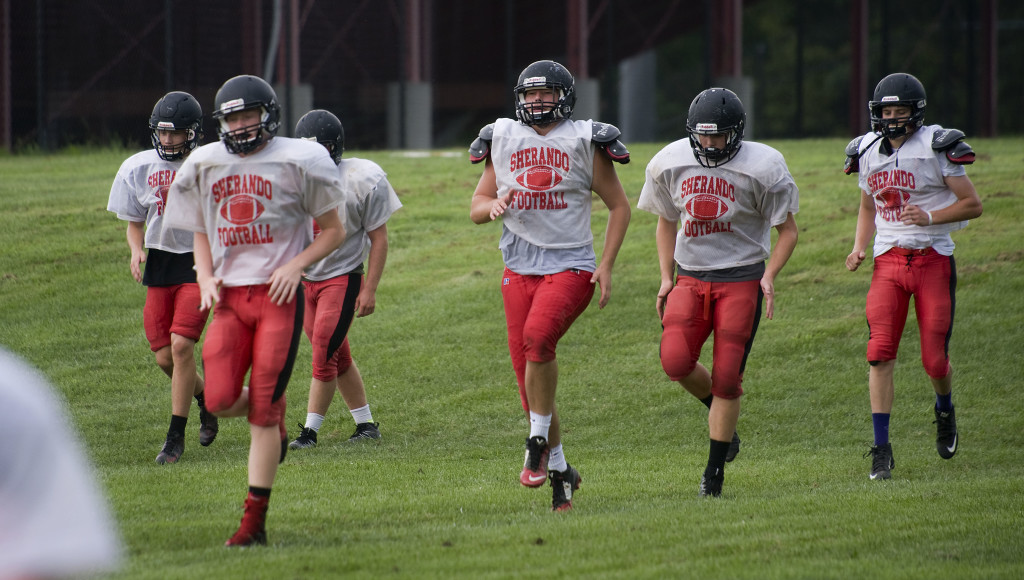 Sherando's football team warms up during a recent practice.  Rich Cooley/Daily