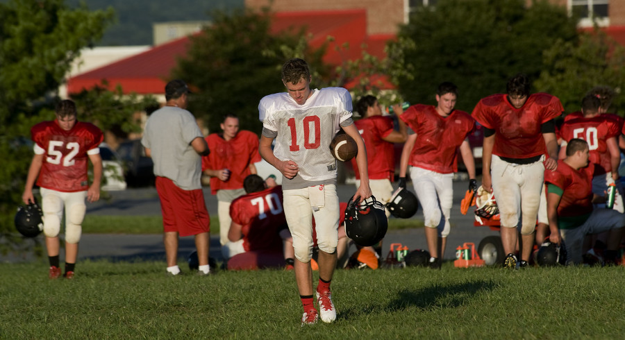 Stonewall Jackson's Brendan Hoover walks with the ball back to the practice field after a break from a recent practice. Hoover will be handling quarterback duties for the Generals this season.   Rich Cooley/Daily