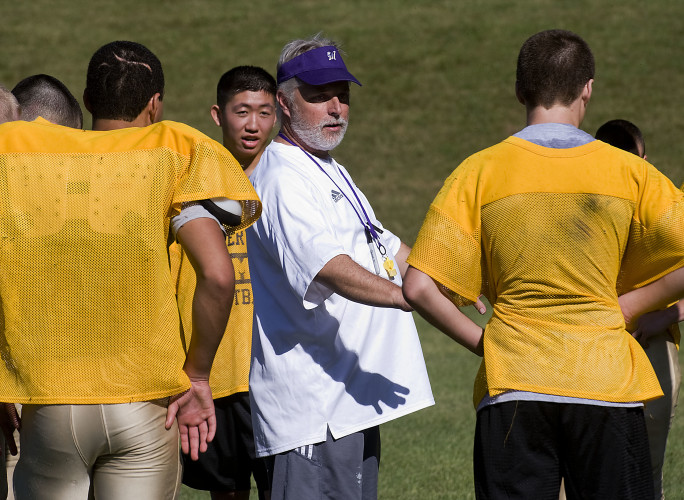 Pete Stone, center, Massanutten Military Academy's new head football coach, prepares to start a drill with his team during a recent practice on the school's football field in Woodstock. Rich Cooley/Daily