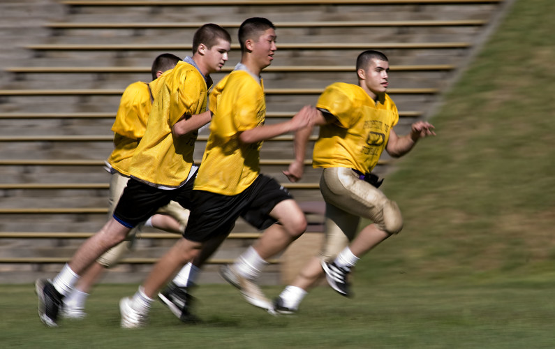 Massanutten Military Academy's football team run sprints during a recent practice on their football field.  Rich Cooley/Daily
