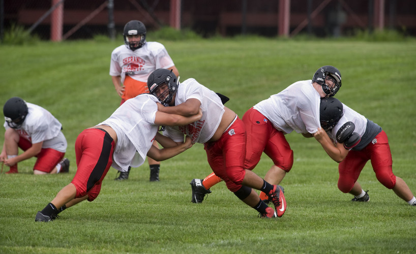 Sherando linemen drill during a recent practice.  Rich Cooley/Daily