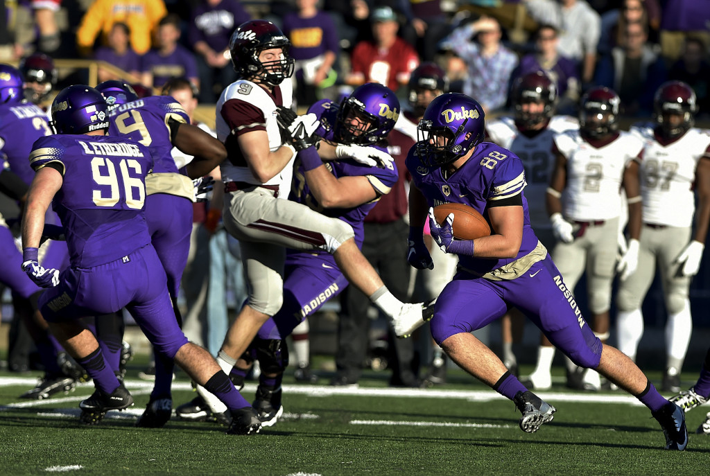James Madison University  junior tight end Jonathan Kloosterman runs after making a catch against Colgate last season. The Strasburg graduate is excited for the opportunity to be the starting tight end this season for the Dukes. Courtesy photo/JMU Athletics Communications