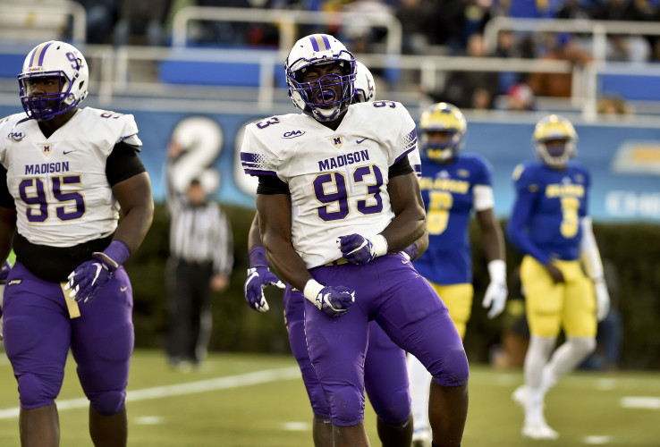 JMU's Andrew Ankrah celebrates a play against Delaware last season. Ankrah, who had 10.5 sacks last year, will be looking to lead the defense again this season. Courtesy photo/JMU Athletics Communications