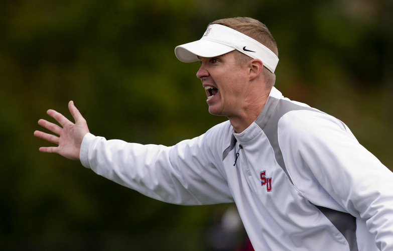 Shenandoah University head football coach Scott Yoder yells during second half action of their home game against Catholic during a 2015 game.  Yoder is entering his fourth season with the Hornets this year.  Rich Cooley/Daily file