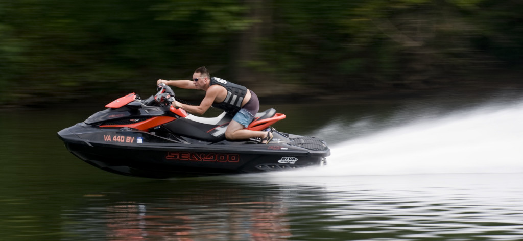 Dave Kinnison, of Winchester, races his jet ski along the Shenandoah River behind the Front Royal Country Club on Friday afternoon.  Rich Cooley/Daily